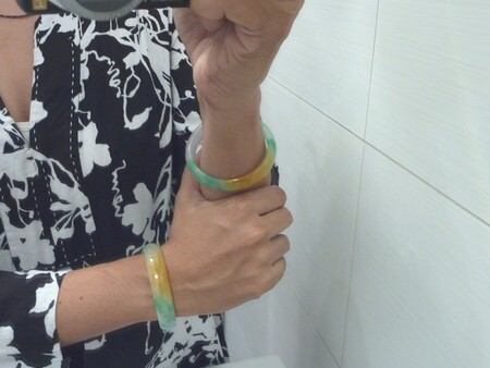women wearing jade bangle bracelets